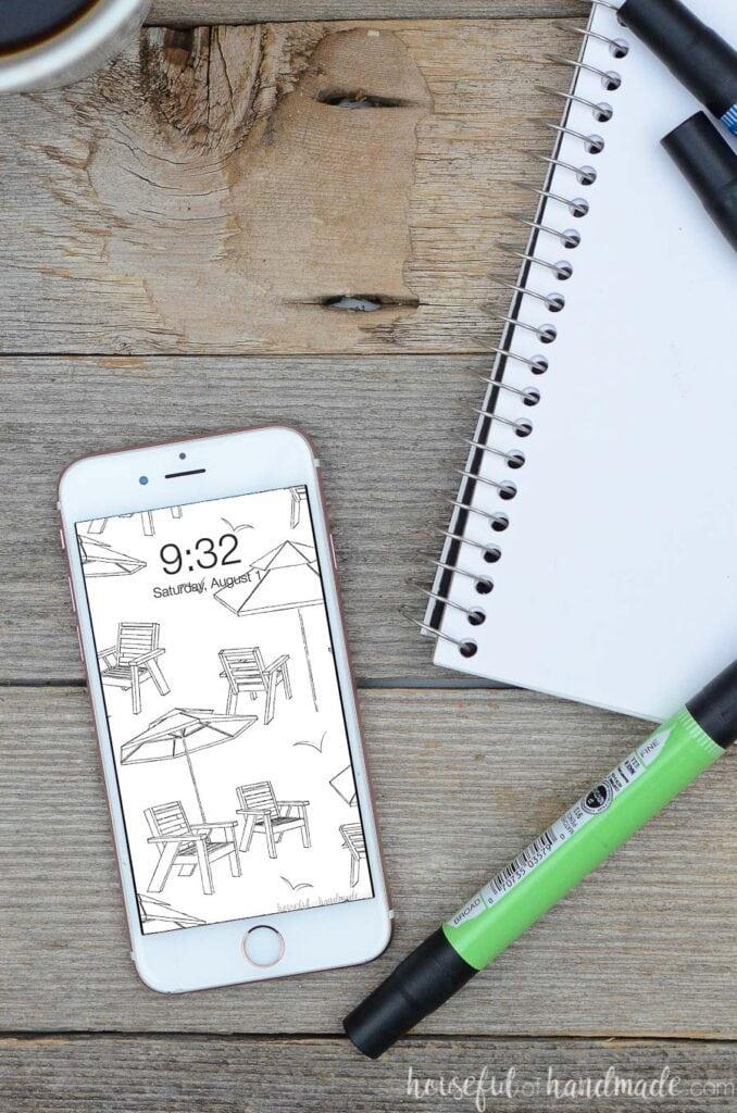 white iPhone with black & white beach umbrella and chair sketch pattern for digital wallpaper.