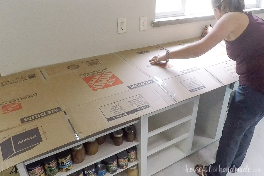 Using cardboard to create a template for DIY countertops.