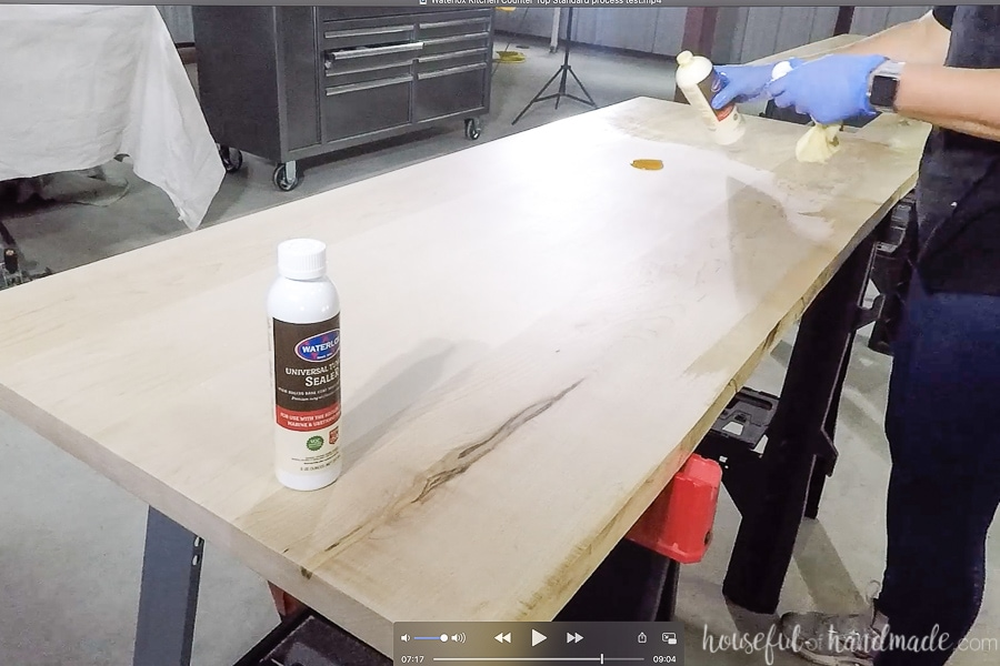 Applying the Universal Tung Oil sealer to the finished countertops by pouring a small puddle of sealer on the wood.