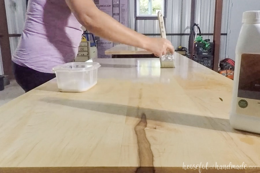 Applying the second coat of H2OLOX finish to the top of the wood countertops.