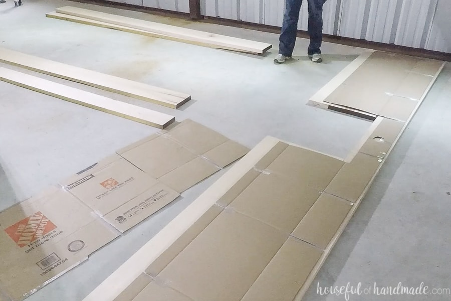 Laying out the boards out under the cardboard template.