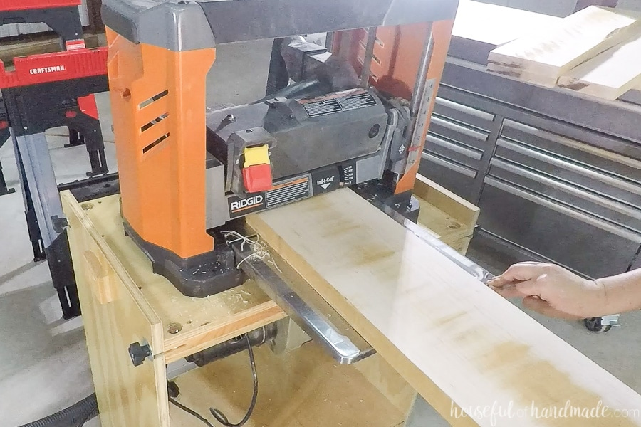 Using a Ridgid brand planer to plane the boards to final thickness.