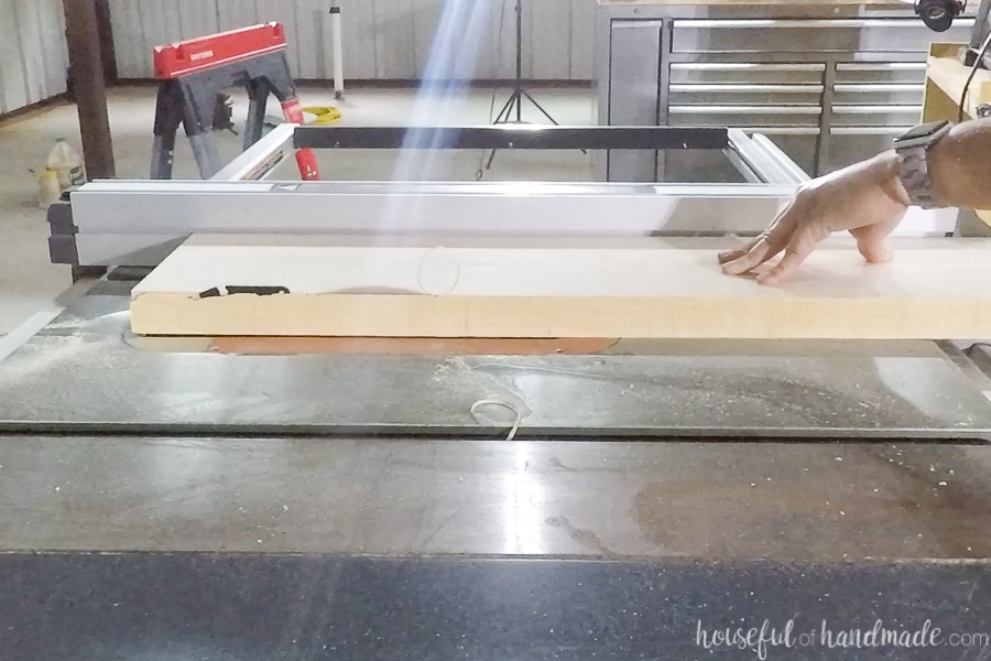 Ripping thick maple boards on a table saw.