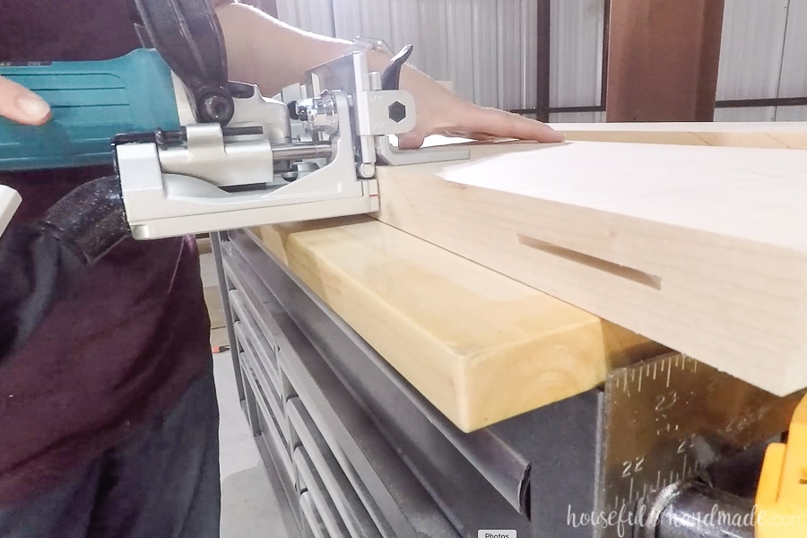 Cutting biscuit slots into the edges of the countertop boards.