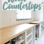 "Picture of maple wood countertops installed over white cabinet carcasses and text overlay ""How to Build & Seal Wood Countertops"" on it."