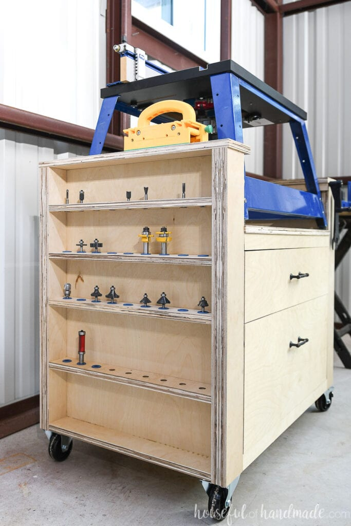 Plywood rolling cart made to hold a Kreg bench top router, with large drawers and router bit storage.