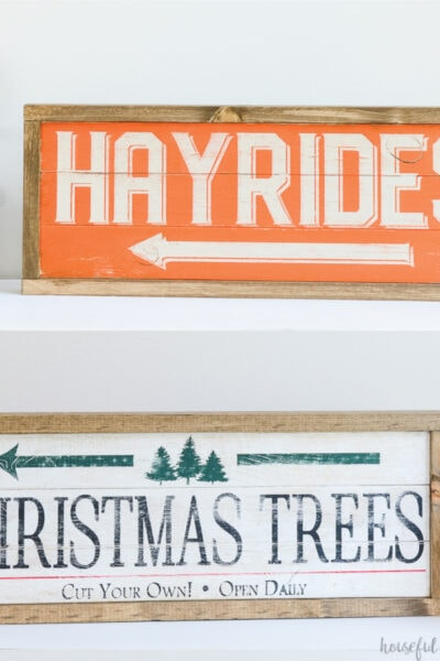 Two pictures of the DIY double sided wood sign: one of the orange and cream Hayrides sign and one of the white, black, green and red Christmas tree farm sign.