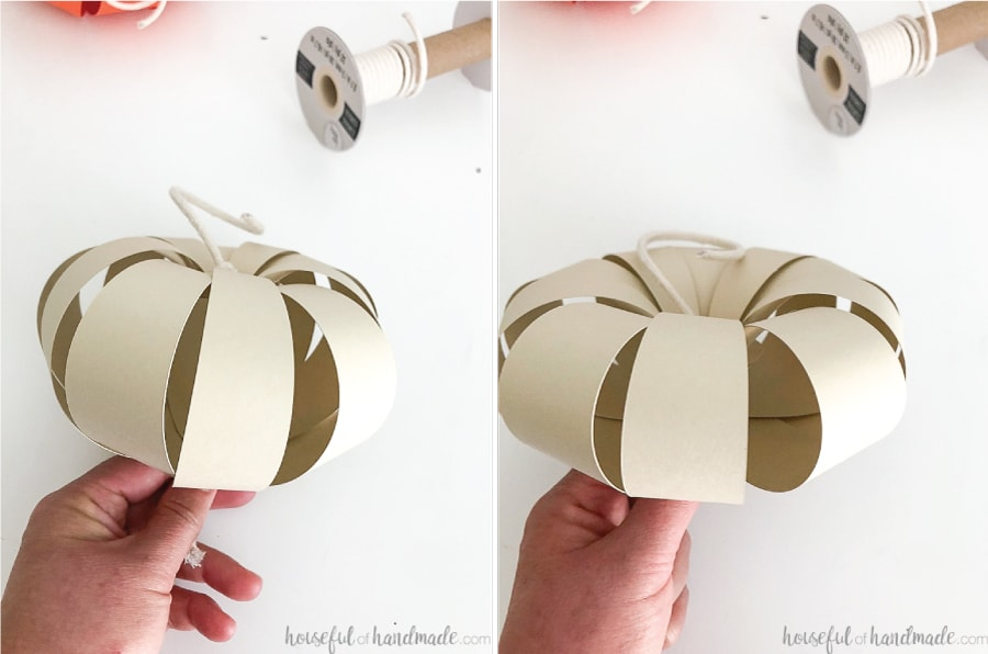 Two pictures of the assembled paper pumpkins showing how you can change the shape by pulling the string tighter.