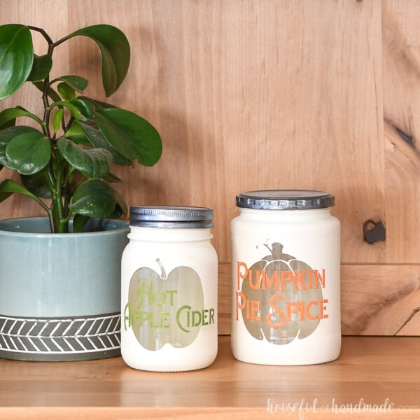 Two DIY kitchen canisters for fall made from upcycled glass jars.