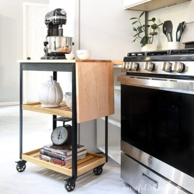 Modern kitchen cart on wheels with a drop down leaf for more counter space when you need it.