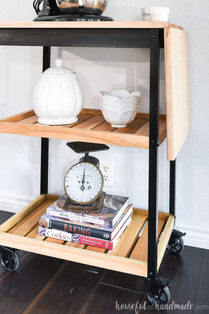 Close up of the two natural wood shelves on the modern kitchen cart.