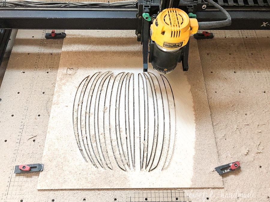 "X-carve CNC machine cutting out the pumpkin design from the 1/4"" plywood."