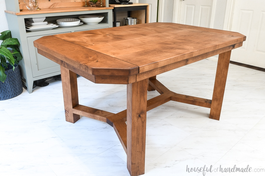 Dining table with breadboard ends that open to hold leaves and sealed with matte unfinished look sealer.