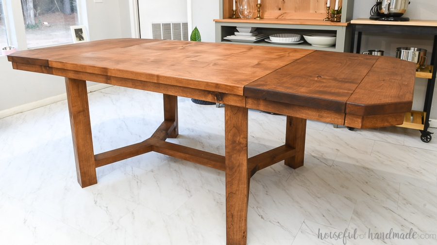 "DIY trestle dining table that is 90"" with both breadboard leaves installed."