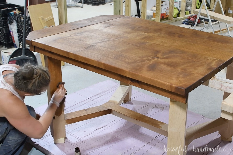 Buffing in the TrueTone color infused tung oil onto the legs of the dining table.