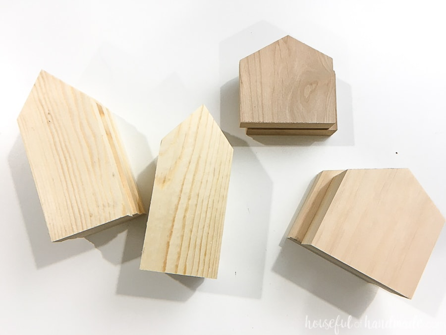 Eight house shaped pieces of wood.