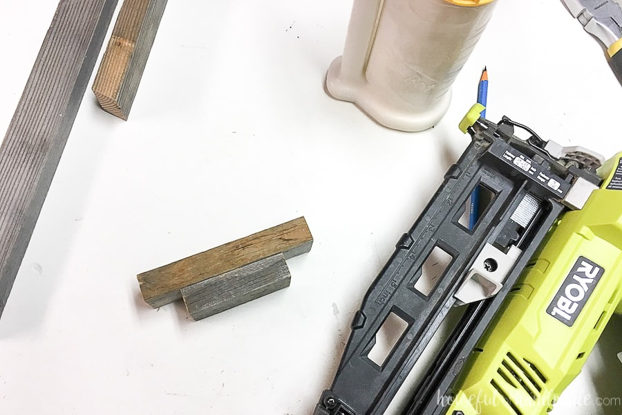 Two small pieces of reclaimed 1x2 nailed together to make the base of the wood Christmas trees.