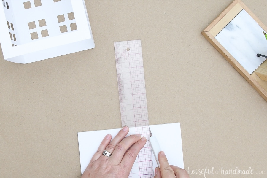 Cutting out a square for the bottom with an x-acto knife and ruler.