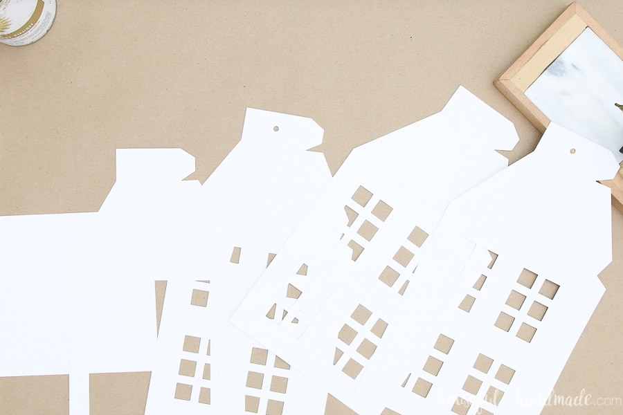 All the pieces for the large paper lanterns cut out and laying on a brown paper surface.