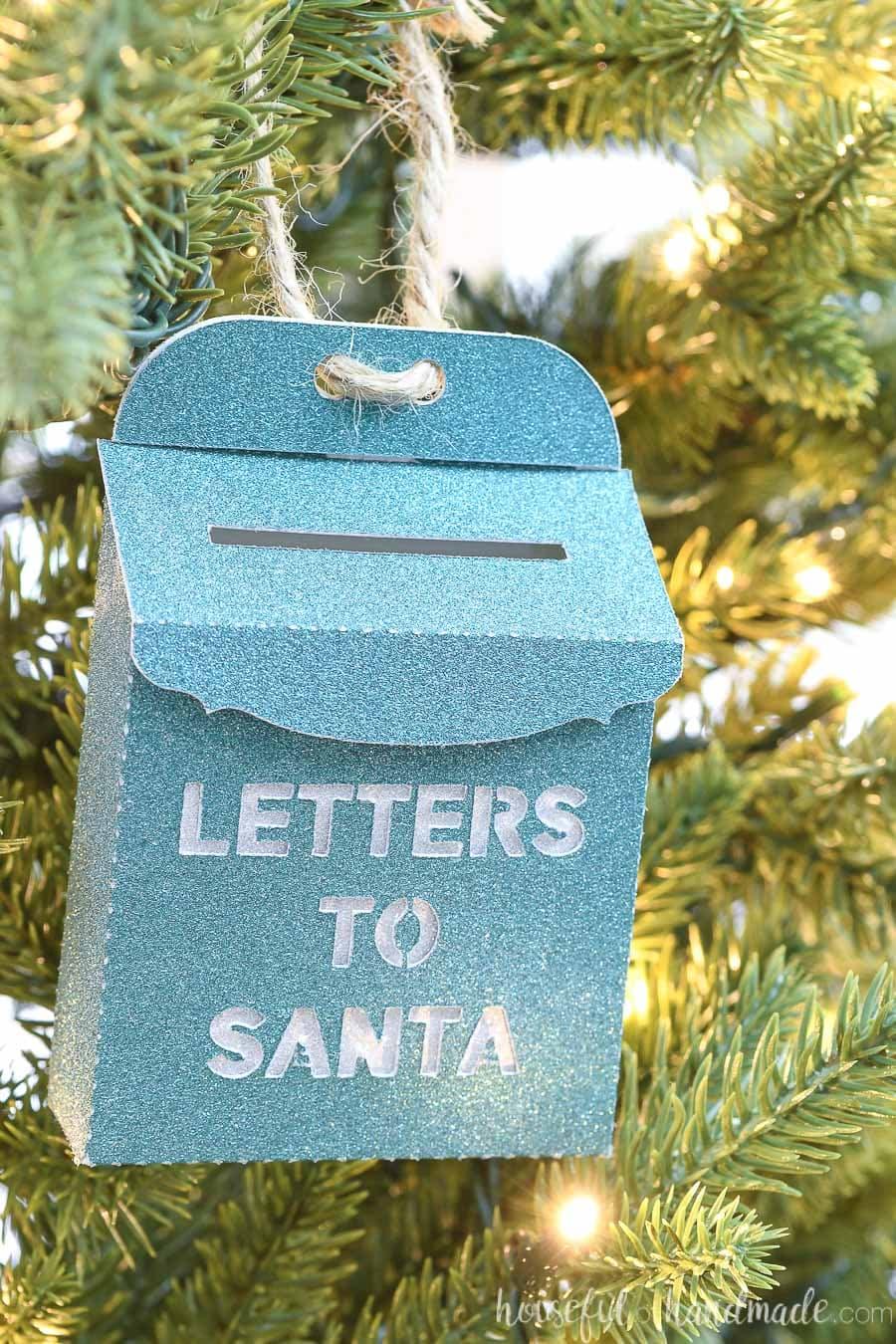 Close up of the green Santa mailbox paper Christmas ornament.