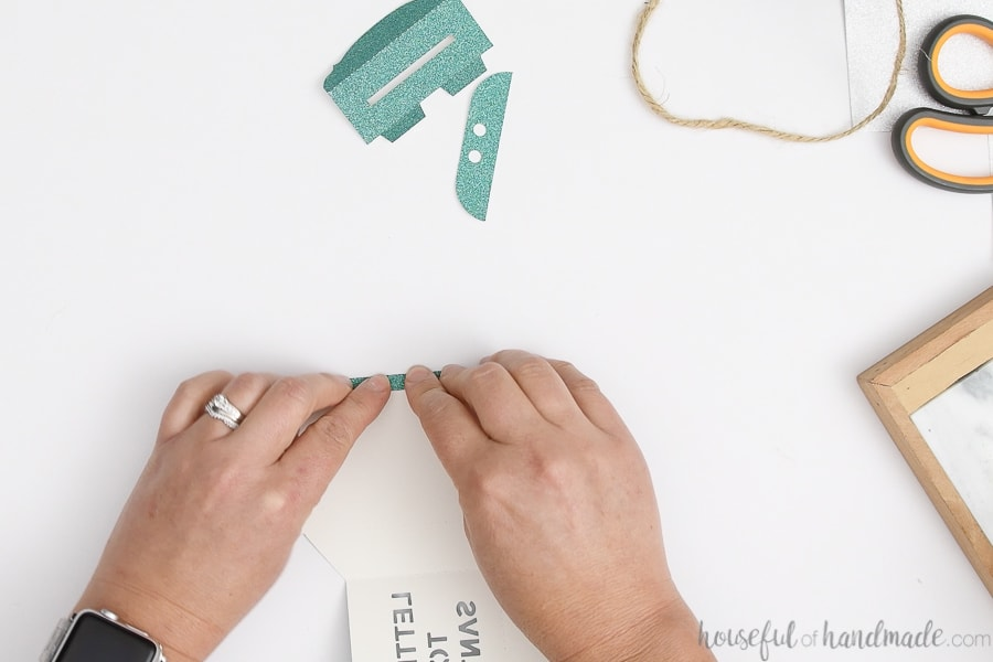 Pieces to make a Letters to Santa mailbox ornament cut out of turquoise green glitter cardstock.