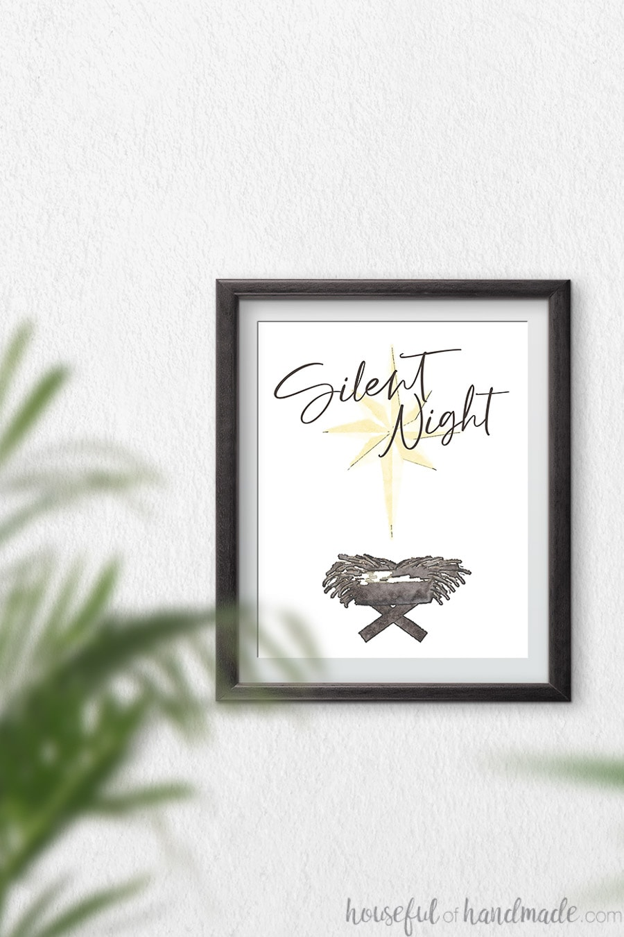 Watercolor Christmas printable of gold star over manger with script Silent Night over it.