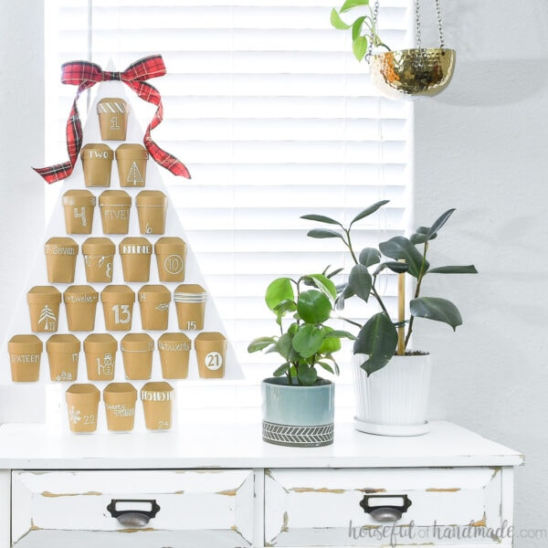 Reusable Christmas advent calendar in a Christmas tree shape with 24 pockets to hold daily advent.