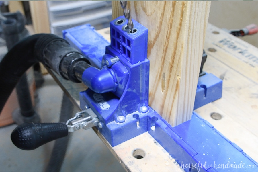 Close up of drilling pocket holes in the 2x8 boards with the Kreg K5 pocket hole system.