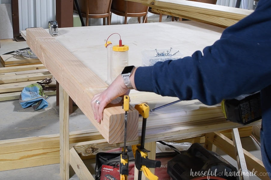 Attaching the top 2x8 board for the headboard with pocket holes.