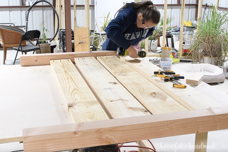 Attaching the second leg to the headboard with pocket holes.