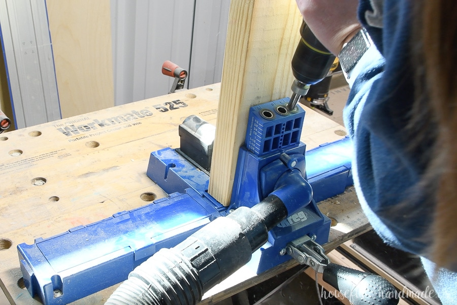 Adding pocket holes to the 2x4 center leg with the Kreg jig.
