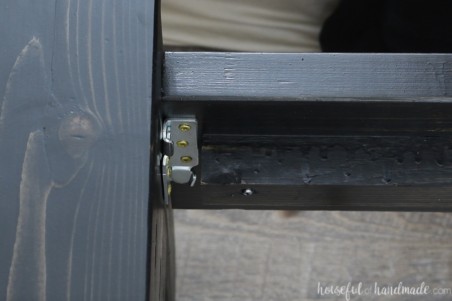 Close up picture of the bed rails attached with the bed rail brackets.