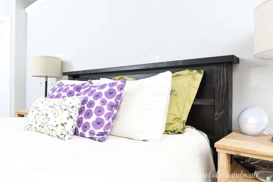 Close up of the easy to build headboard as part of the queen bed frame tutorial.