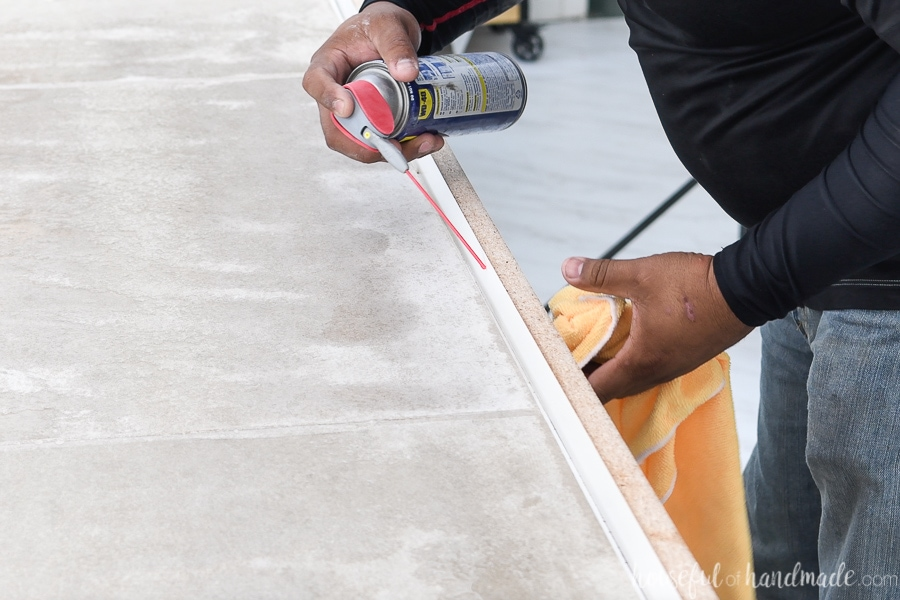 Adding WD40 to the inside of the concrete countertop form and wiping away the excess with a clean rag.