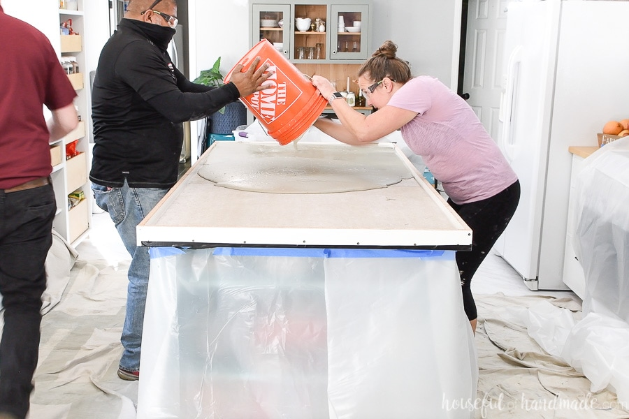 Pouring the second bucket of mixed Cement All with the additives into the kitchen island form.