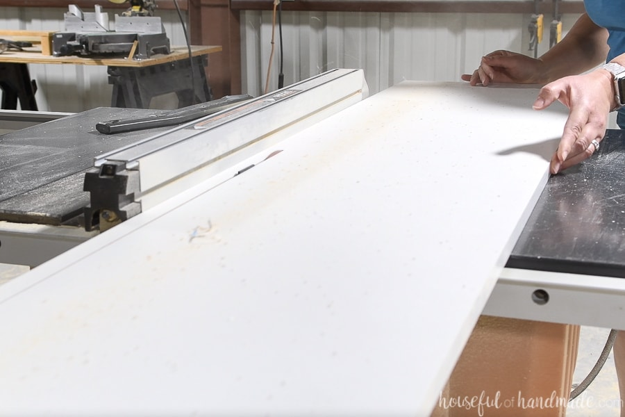 Ripping melamine covered strips on a table saw for the countertop forms.