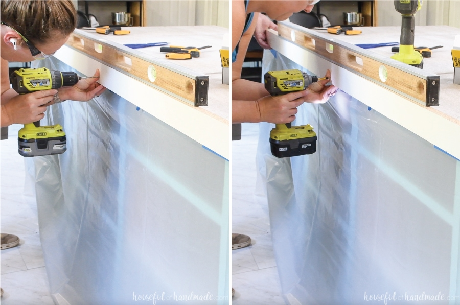 Attaching the larger melamine strips to the side of the concrete forms with a level on top.