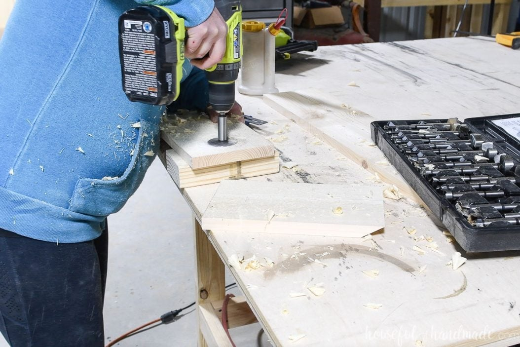 """Drilling a 2"""" hole in the top of one of the boards with a forstner bit."""