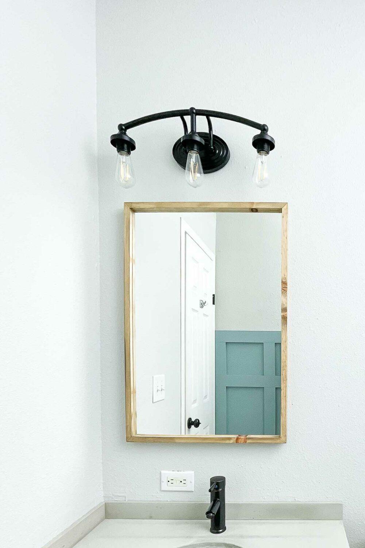 Thin framed bathroom mirror in the $100 bathroom remodel.