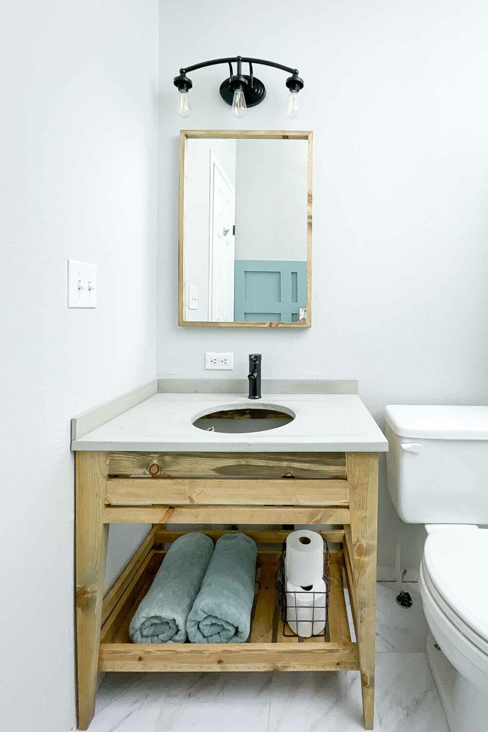 Bathroom remodeled for $119 with a new vanity, floor, paint and more.