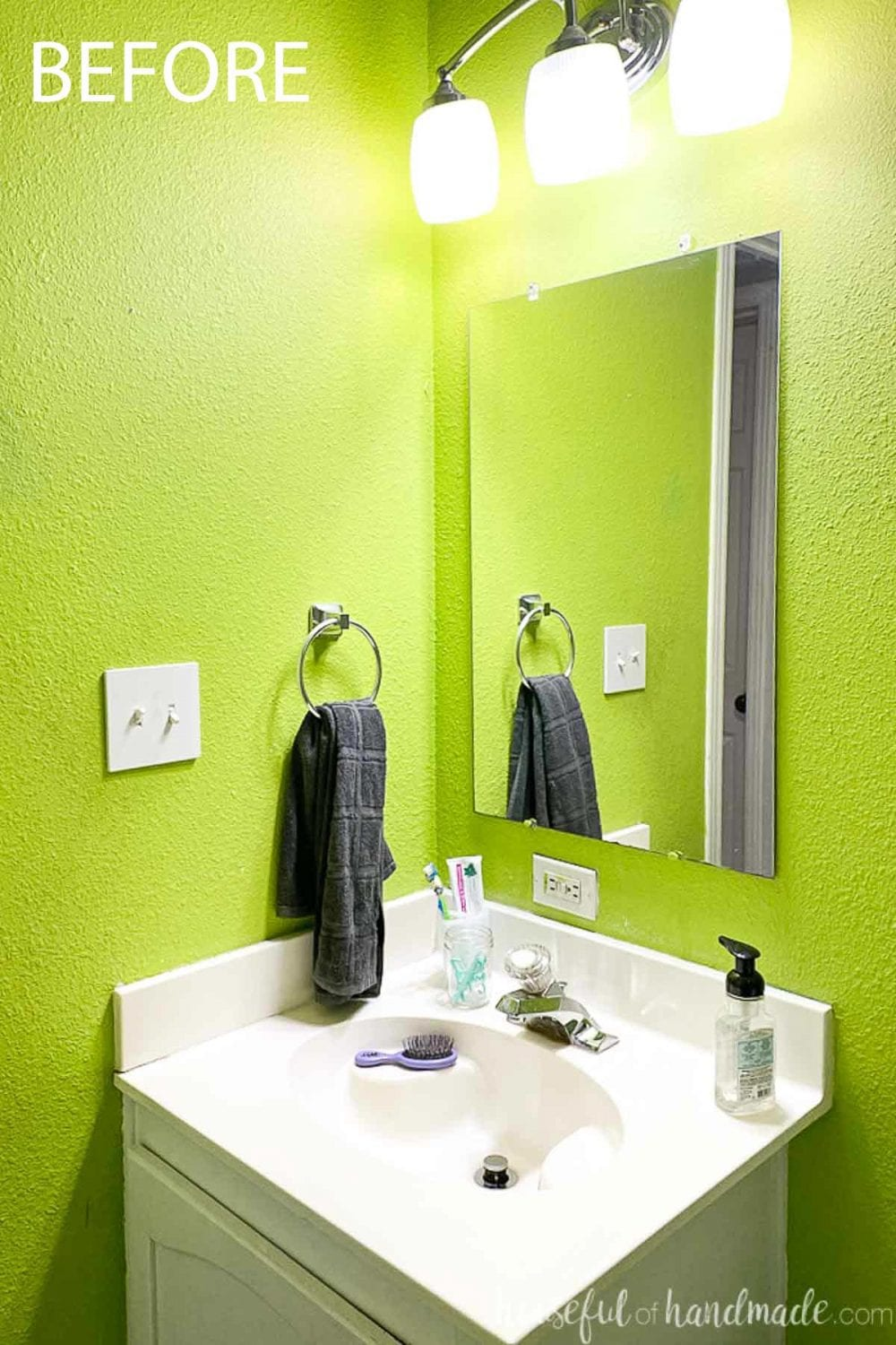 Before photo of the bathroom vanity top with a plain mirror on the wall.