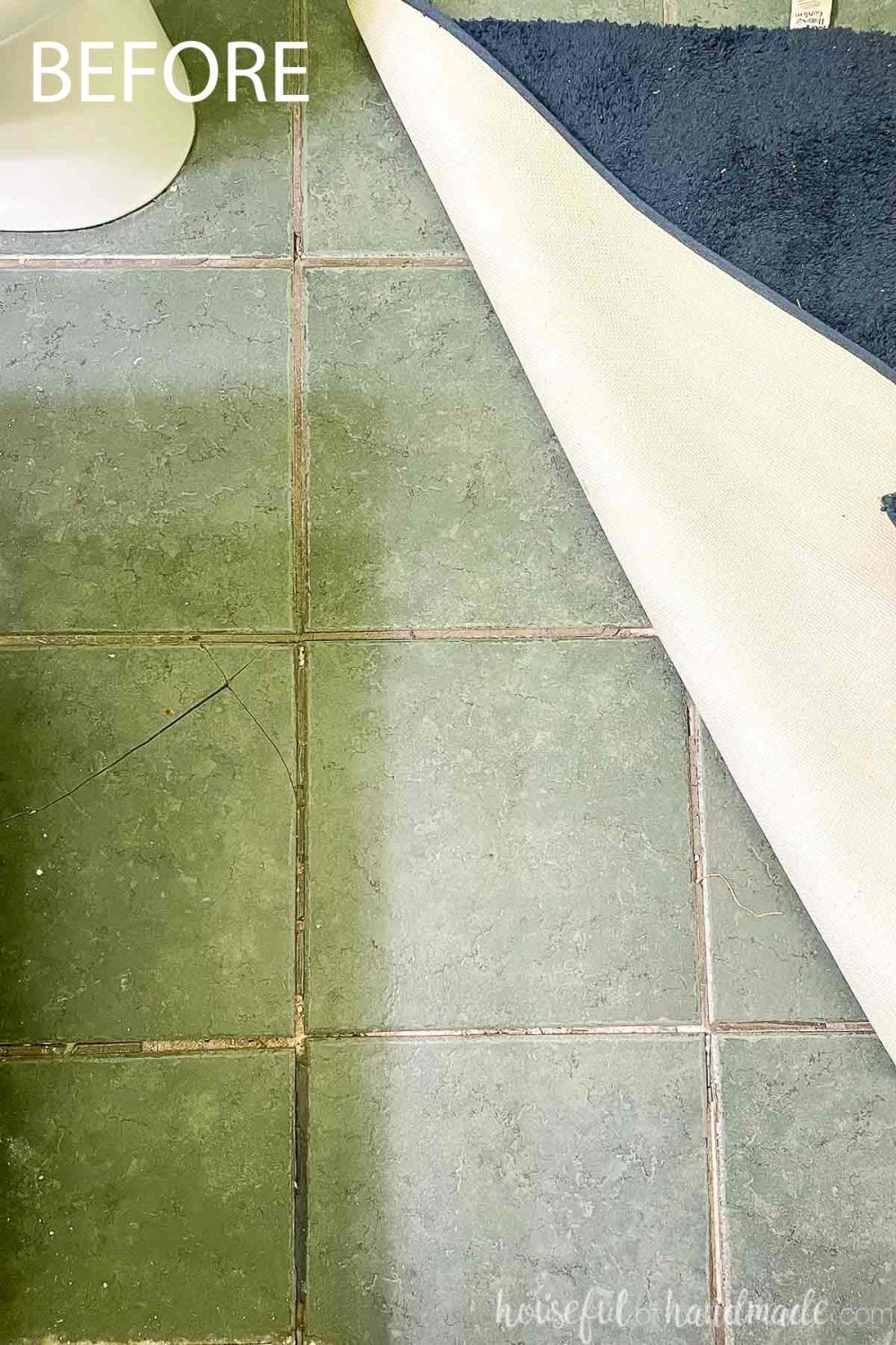 Picture of the broken tile flooring in the bathroom that needs to be updated.
