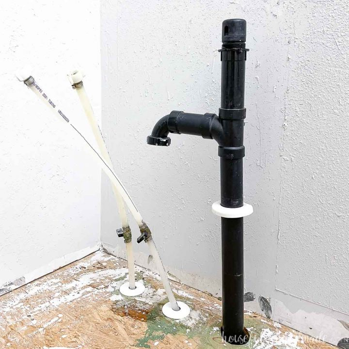 Picture of the pipes found inside the bathroom sink during the budget bathroom makeover.