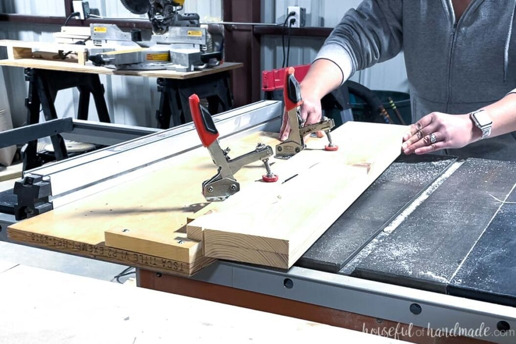 Cutting a tapered for the bathroom vanity legs on a table saw with a homemade tapered leg jig.