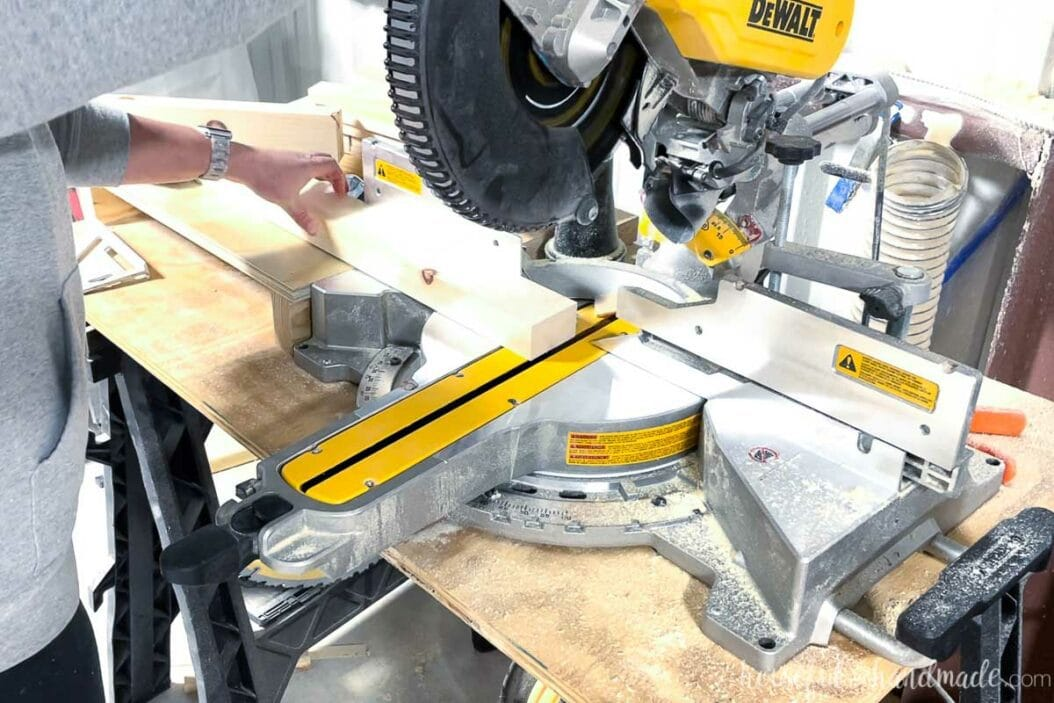 Cutting the 2x4 piece on a miter saw at a 5 degree angle.