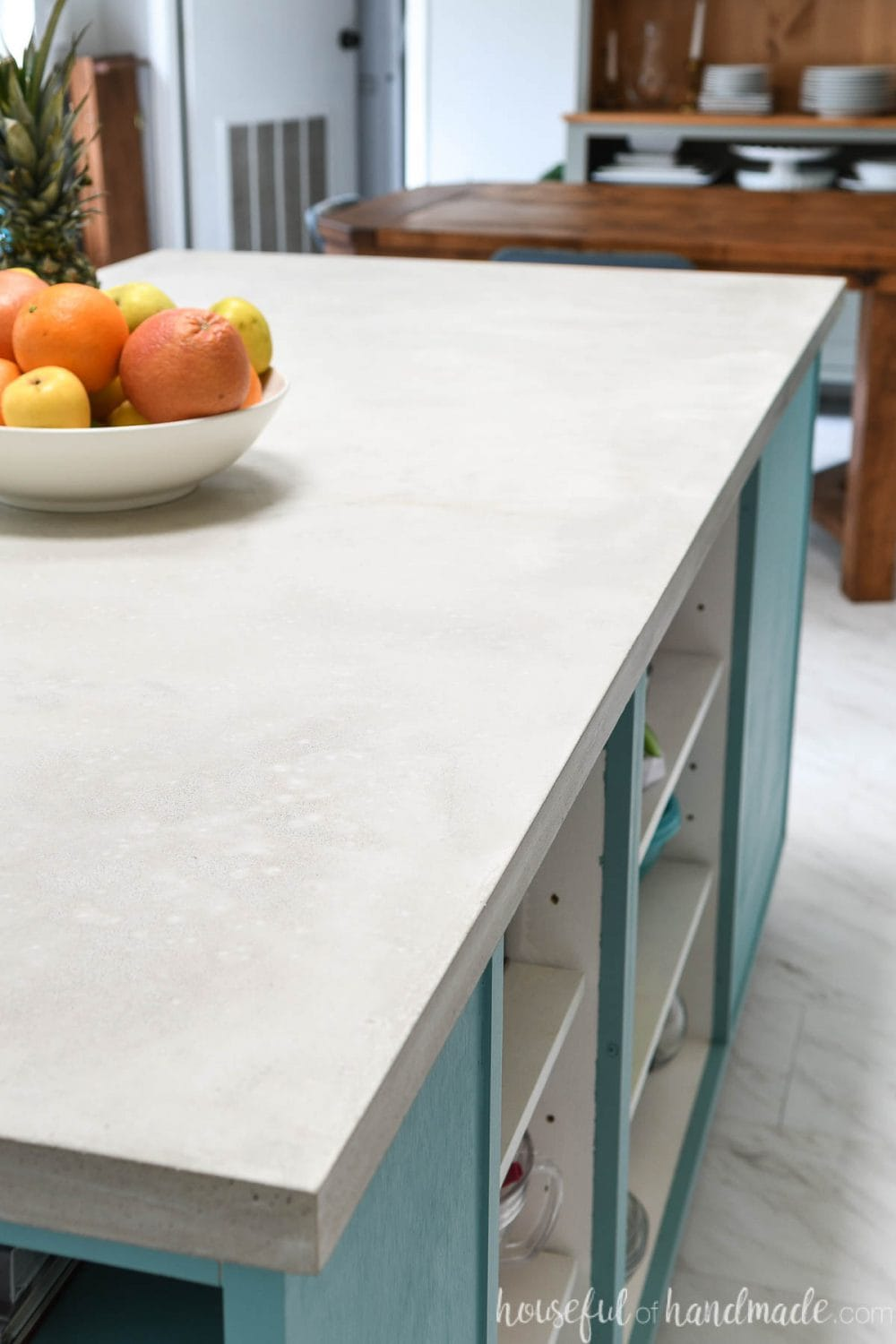 Side of a colorful kitchen island with a DIY concrete countertop.