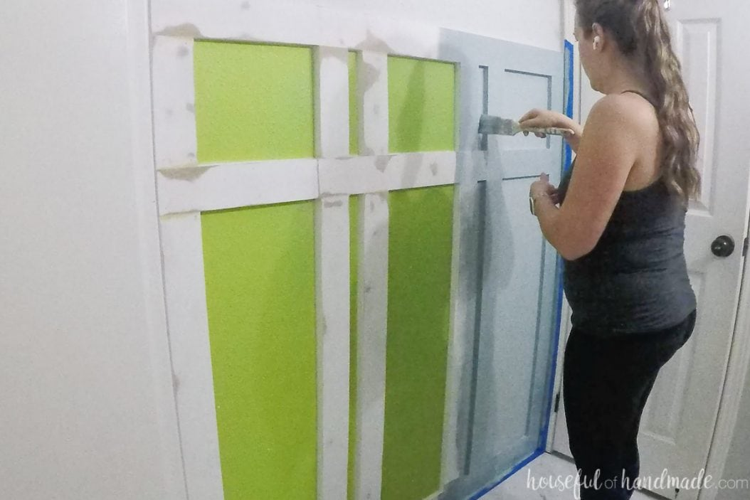 Painting the board and batten wall in the bathroom.