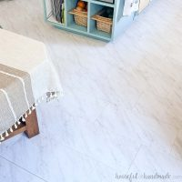 Looking down on the peel and stick vinyl floor installed in the kitchen and dining room.