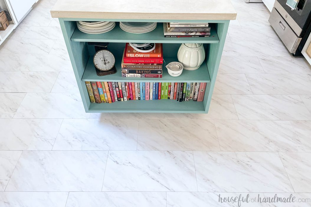 White and gray marble vinyl tiles on the floor in around the colorful kitchen island.