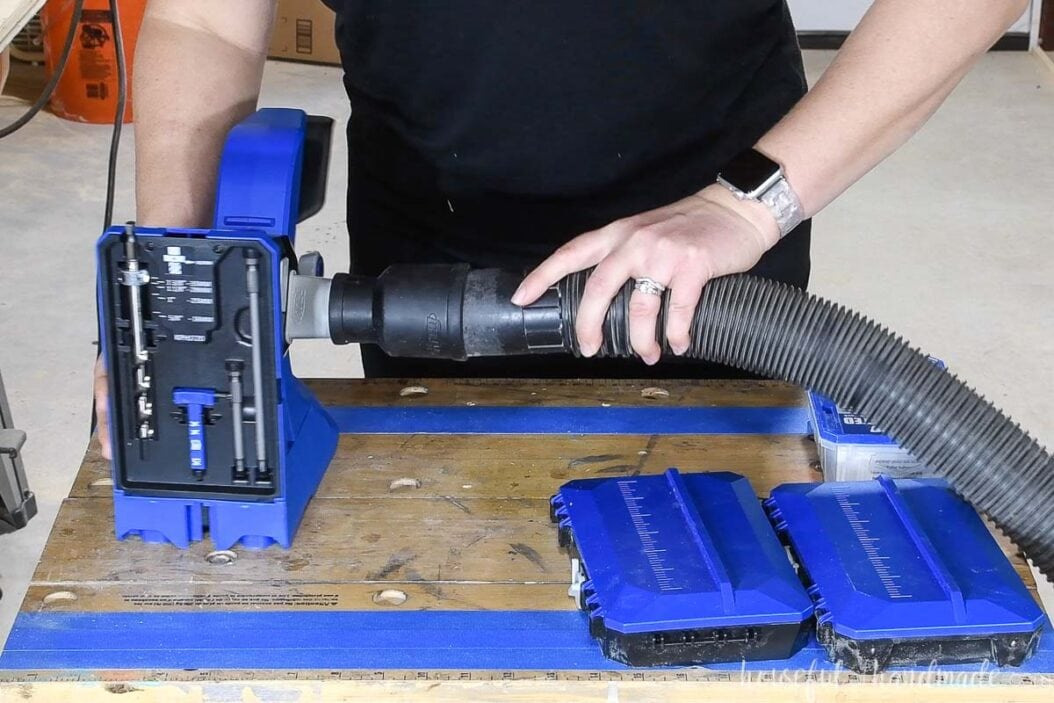 Dust blade adapter on the pocket hole jig with a shop vac hose attached.